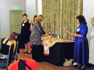 Christina lighting her Secretary candle